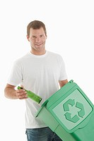 Man throwing glass bottle in the recycling bin (thumbnail)