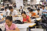 SHENZHEN, GUANGDONG PROVINCE, CHINA _ Workers sewing Mango jeans, in garment factory in city of Shenzhen, one of mainland China´s first Special Econom...