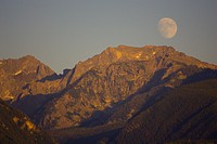 PINE CREEK, MONTANA, USA _ Moon rises over Absaroka Range, part of the Rocky Mountains, in the Gallatin National Forest, as seen from Paradise Valley.