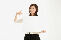 Businesswoman holding board