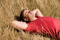 A young man lying in the sun