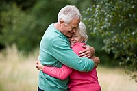 Portrait of a senior couple hugging, outdoors