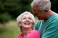 Portrait of a senior couple embracing, outdoors