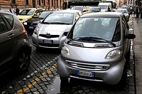 Parked small cars in Rome