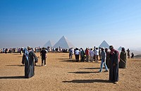 Egypt, Cairo. Giza Pyramids, Cheops,Chepren and Mycerinus with tourists
