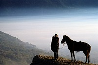 Indonesia, Java. Man with horse at the foot of Mt. Bromo volcano