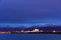 Skyline view of Anchorage as seen from Earthquake park at sunset with Cook Inlet in the foreground, Alaska
