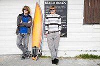 Teenage boys with surfboard (thumbnail)