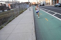 Male runner on urban street (thumbnail)