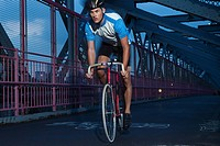 Cyclist riding on bridge