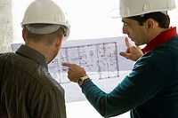 Building contractor explaining blueprint