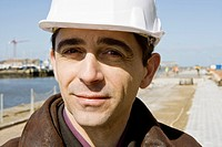 Building contractor in hard hat, portrait