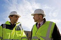 Building contractor and businessman in hard hat and reflective clothing