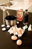 Egg, tomato juice and beverage with sauce pan in the kitchen