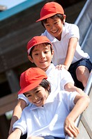 Elementary school boys on slide, Japan