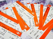 Train tickets on twenty pound notes  England, United Kingdom