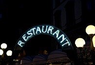 Neon Restaurant sign at night