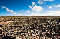 Volcanic landscape under a blue sky.