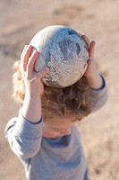 Boy Holding Globe Of Earth
