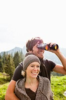 Couple with binoculars watching scenery
