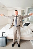 Business man with his luggage in bedroom