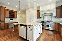Kitchen in new construction home with wood cabinetry