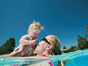 Mother and daughter 12_18months playing at swimming pool