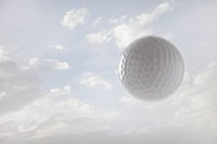 Golf ball against sky