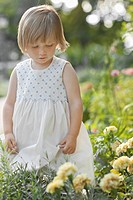 Girl 2_3 by flowers in garden