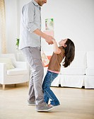 Daughter standing on father´s feet and dancing