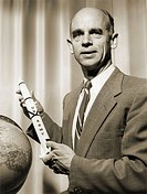 Ernst Stuhlinger 1913_2008, German rocket scientist, holding a model rocket. Dr Ernst Stuhlinger was a German_born American atomic, electrical and roc...