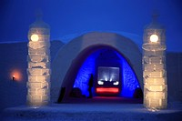 Ice hotel entrance. Ice hotels are built entirely from snow and ice in cold polar regions. They are built during the winter, usually by spraying snow ...