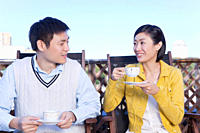 Young couple drinking tea
