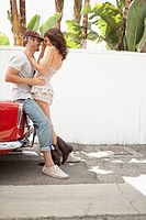 Couple by vintage car