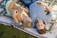 Couple lying on a picnic blanket