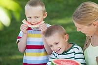Mother and boys with watermelon
