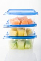 Healthy sliced fruit in plastic containers