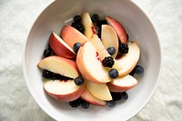 Apple slices and berries in a bowl