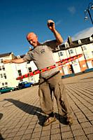 A Aberystwyth university student using hoolah hoops outdoors, UK