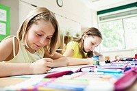 Girls painting in classroom (thumbnail)