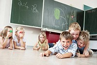 Children playing on floor in classroom