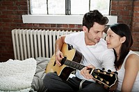 Young couple relaxing with a guitar