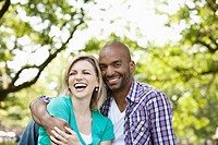 Young couple having a laugh in a park