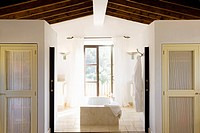 Open bathroom in rustic villa