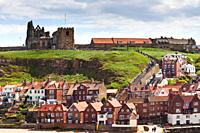 Whitby beach, Abbey and church above the harbour entrance Whitby North yorkshire England UK