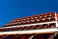 Orange Awnings Covering Windows Against Blue Sky, Low Angle View