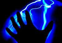 Silhouette of Hand on Blue Electricity