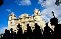 People stand outside Oaxaca´s Metropolitan Cathedral in Mexico. The cathedral was built by the Spanish in 1553 and renovated in 1730 after an earthqua...