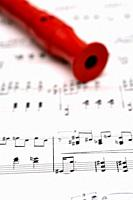 red flute on music sheet