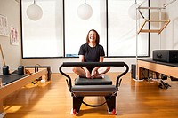 Art Science Physical Therapy and Pilates, Certified Pilates Rehabilitation Practitioner and owner Serene Renee Calkins with female patient demonstrati...